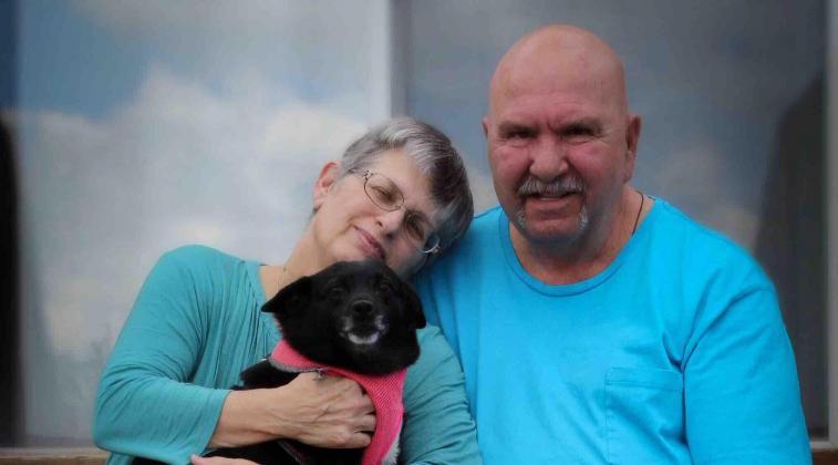 Toni with her husband, Ben, and dog, Midge