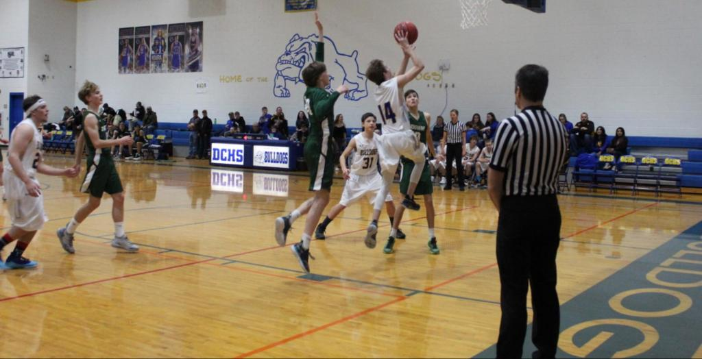 Photo by Sadie Cressler/Freshman Tanner Williams (#14) at the net
